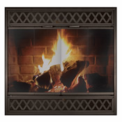Glass and mesh fireplace door with black steel frame and geometric design over a wood fire