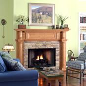 Wood finish fireplace mantel surrounding a masonry fireplace