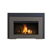 Black direct vent fireplace with fire glass media bed and glowing fire inset into a natural-colored brick hearth
